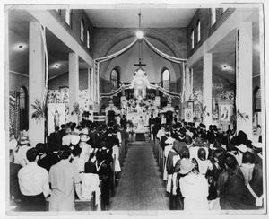 Primary view of object titled '[Photograph of Mass in session at a church]'.