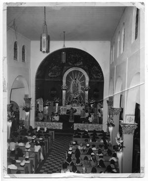Primary view of object titled '[Photograph of Mass service in a church]'.