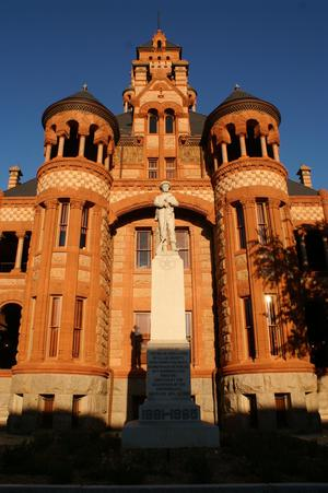 [Statue and courthouse]