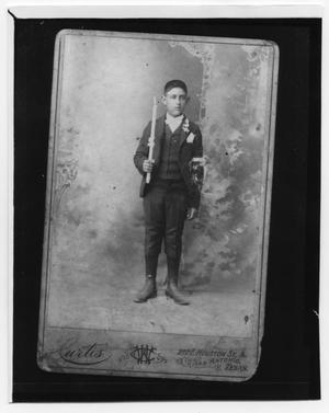 [Photograph of a young boy in a suit]