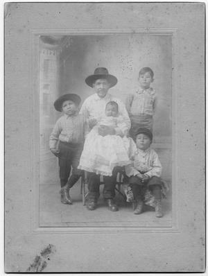 Primary view of object titled '[Family photograph of a man holding a baby and three boys]'.