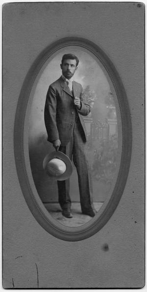Primary view of object titled '[Photograph of a man wearing a wide brimmed hat]'.