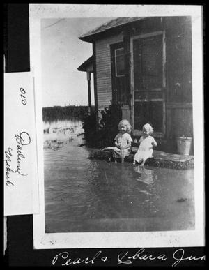 Primary view of object titled '[Children Playing in Flood Water]'.