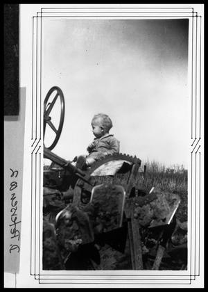 Primary view of object titled 'Donald G. Petersen on Tractor'.