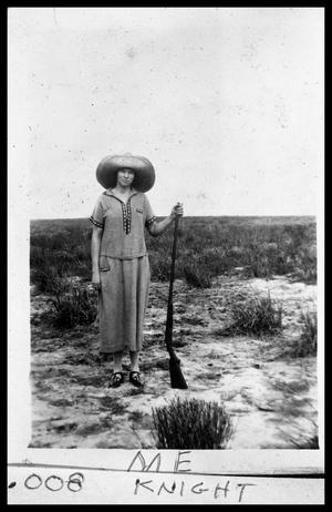 Primary view of object titled 'Edith Rasmussen Holding Shotgun'.
