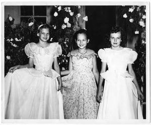Primary view of object titled '[Three Girls at the 1950 Mayfest Celebration]'.
