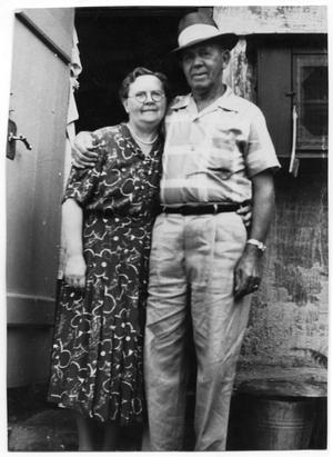 Primary view of object titled '[Dagny and Andrew Jensen in Front of their Home]'.