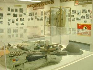 Primary view of object titled '[Exhibit of military items]'.