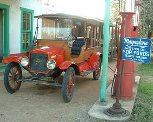 Primary view of object titled '[Antique car and gasoline pump]'.