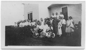 Primary view of object titled 'Group Photo in Front of House'.