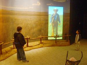 [Two boys looking at exhibit]