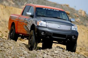 Primary view of object titled '[Black and orange Nissan truck on hill]'.