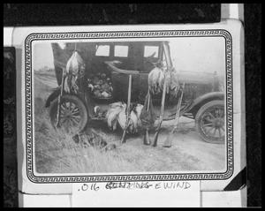 Primary view of object titled '[Morning Kill Hanging From an Automobile After a Hunt]'.
