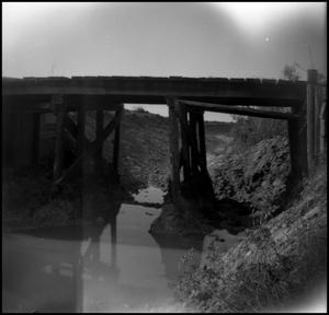 Primary view of object titled '[Wooden Bridge over a Shallow Creek]'.