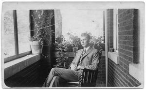 Primary view of object titled '[Ernest Recane Seated in Chair]'.