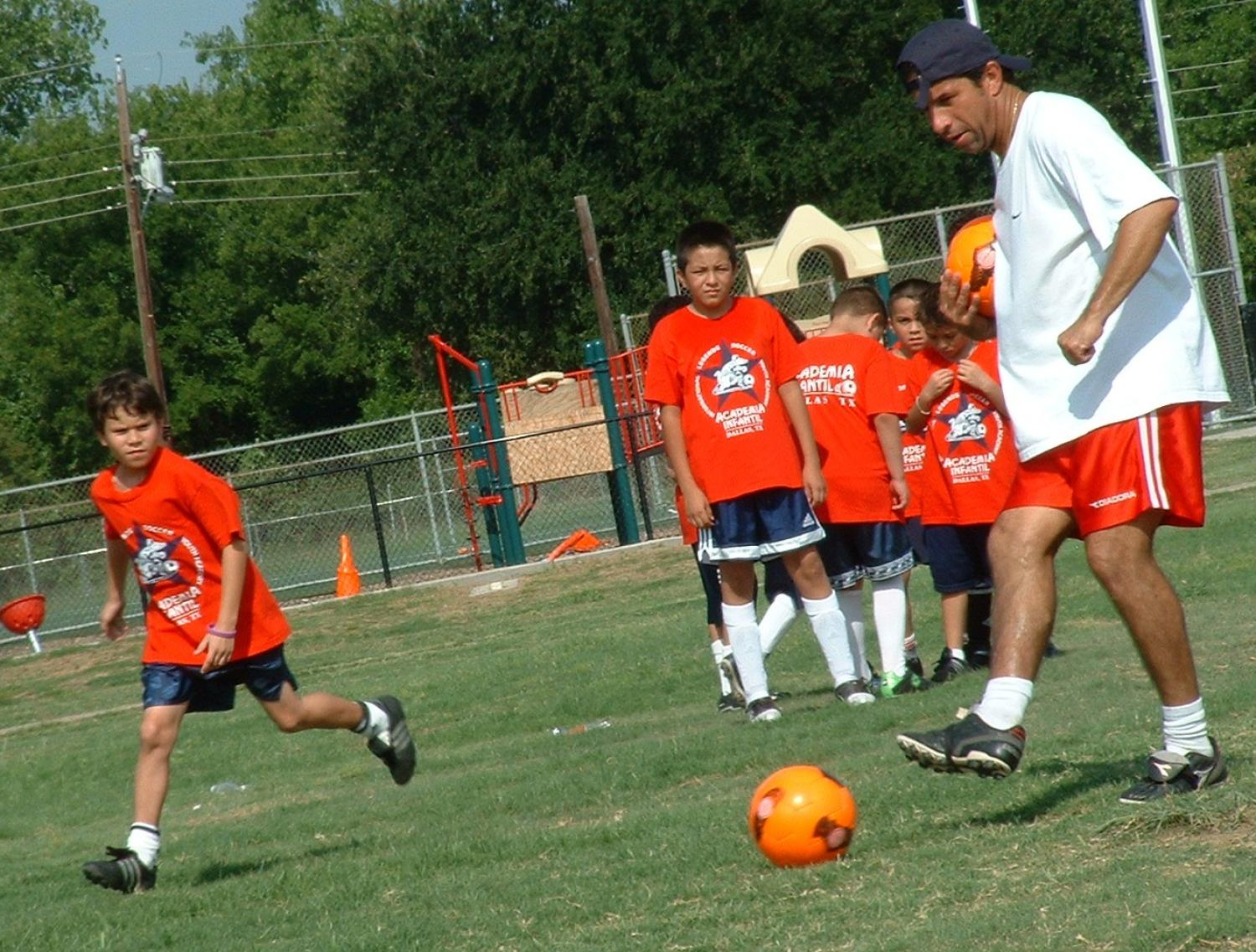 [Boys engage in soccer drills]                                                                                                      [Sequence #]: 1 of 1
