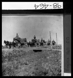 Primary view of object titled 'Wagons Hauling Cotton'.