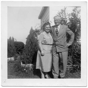 Primary view of object titled '[I. E. (Babe) Hansen and Alice Hansen in Front of House]'.