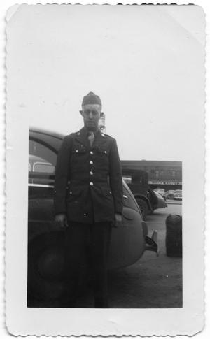 Primary view of object titled '[Melvin Hansen at Wholesale Candy Parking Lot]'.