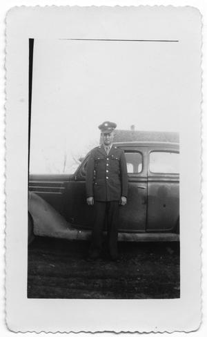 Primary view of object titled '[Melvin Hansen in Front of Automobile]'.