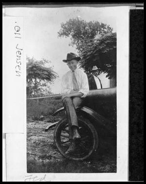 Primary view of object titled '[Theodore Jensen Sitting on Fender of Model T]'.