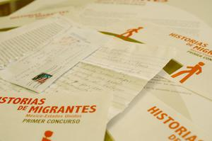 Primary view of object titled '[Close-up of letters and brochures on desk of Oscar Solis Flores]'.