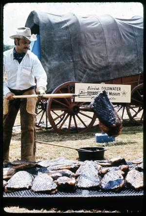 Primary view of object titled '[Cowboy Grilling Beef]'.