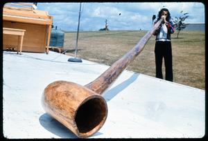 Primary view of object titled '[Man Playing Cypress Knee Horn]'.