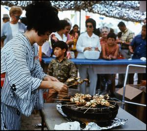 Primary view of object titled '[Woman Cooking Chicken Teriyaki]'.