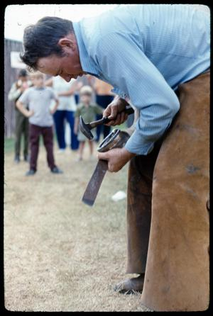 Primary view of object titled '[Man Nailing in Horseshoe]'.