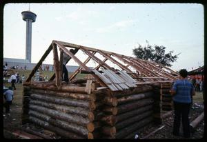 Primary view of object titled '[Log Cabin Nearing Completion]'.