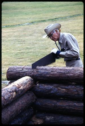 Primary view of object titled '[Man Sawing a Log]'.