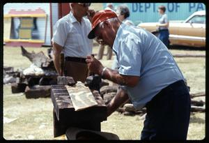 Primary view of object titled '[Man Making Roof Shingle for Log Cabin]'.