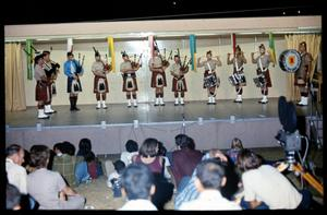 Primary view of object titled '[Alamo City Highlanders Pipe Band Performs Onstage]'.