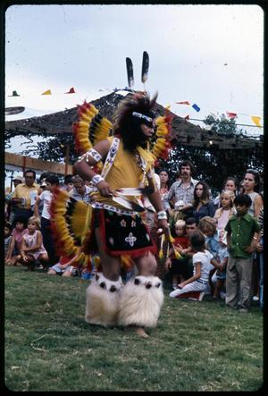 Primary view of object titled '[Alabama-Coushatta Indian Dancer Performing]'.