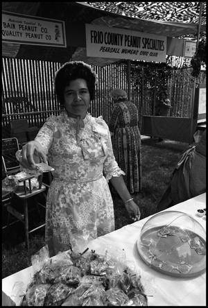 Primary view of object titled '[Woman in Peanut Specialties Booth]'.