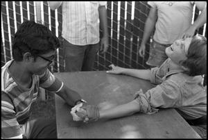 Primary view of object titled '[Arm Wrestling Contest]'.