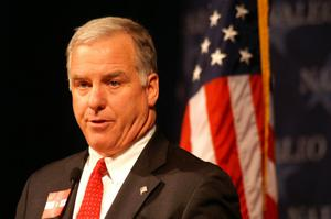 Primary view of object titled '[Howard Dean speaking in front of American flag]'.