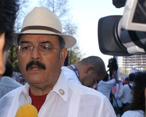 Primary view of object titled '[Hector Flores in crowd with news media camera and microphone]'.