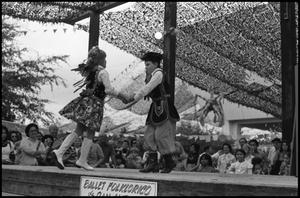 Primary view of object titled '[Young Children Performing on the Ballet Folklorico Stage]'.