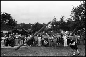 Primary view of object titled '[Man Participating in the Scottish Sport of Caber Throwing]'.