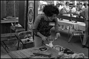 Primary view of object titled '[Dinah Crowley Creating Stained Glass]'.