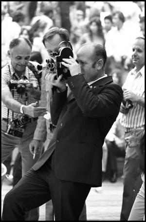 Primary view of object titled '[Alexey A. Leonov Filming at the Texas Folklife Festival]'.