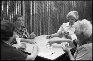 Primary view of object titled '[Group of Older Women Table Playing Bien]'.