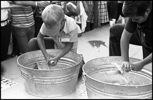 Primary view of object titled '[Children Compete in Corn Shucking Contest]'.
