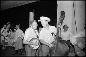Primary view of object titled '[Two Members of the East Texas String Ensemble Performing]'.