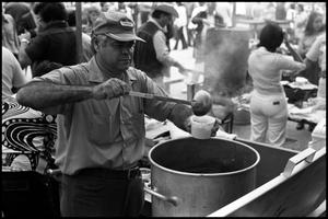 Primary view of object titled '[Man Serving Menudo for Project SER]'.
