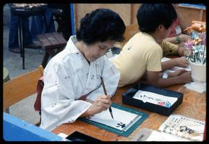 Primary view of object titled '[Japanese Calligraphist at Work]'.
