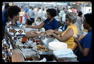 Primary view of object titled '[Mt. Sinai Baptist Church Selling Soul Food]'.