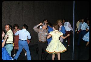 Primary view of object titled '[Dancing with Alamo Area Square Dancers]'.